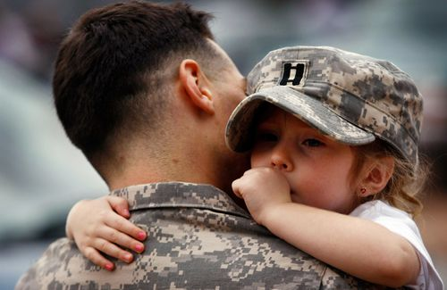A dad and his little girl.  Welcome home soldier!